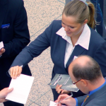 How should a woman dress for a B2B meeting?